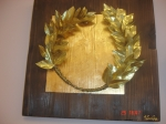 Wreath golden film on wood